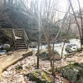 The lower trail once again crosses the river at the second bridge.- Cascade Falls