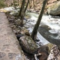 Some of the trail is paved, while other parts of the lower trail are have trickier footing.- Cascade Falls