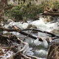 Winter hiking and cold weather creates a winter wonderland of ice and running water.- Cascade Falls