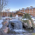 A water feature completes the landscaping in front of the lodge.- The Sun Valley Lodge