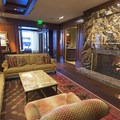 There is a large granite fireplace in the lobby.- The Sun Valley Lodge