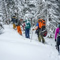 Skinning up to the yurt in deep snow.- Backcountry Skiing the Baldy Knoll Yurt