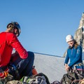 Swapping snow climbing gear for rock climbing gear.- Bugaboo Spire via Kain Route