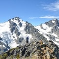 Summit of Vantage with Mount Matier and Joffre Peak in the background. This photo has an excellent view of Joffre's northeast ridge scramble route.- Vantage Peak