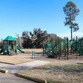 A playground structure in the large central lawn area.- Fontainebleau State Park