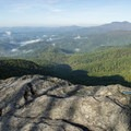 Looking over the top of Blowing Rock, Grandfather Mountain, and more of the Blue Ridge.- Blowing Rock