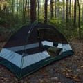 Each site has a gravel tent pad.- Raymond Fisher Campsites