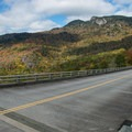 The Blue Ridge Parkway and Grandfather Mountain towering above.- Linn Cove Viaduct