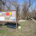 An informational sign marks the entrance to the trail.- Bonnet Carre Spillway