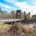 Lacombe Trailhead is at a working bridge over Lacombe Bayou.- Tammany Trace