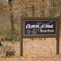 Greeting sign for visitors of the state park.- Chemin-A-Haut State Park