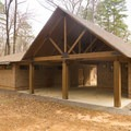Spacious and nice bathhouse offers hot showers. - Chemin-A-Haut State Park