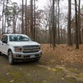 A camper's truck at one of the campsites found at Chemin-A-Haut.- Chemin-A-Haut State Park