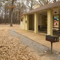 Unique covered picnic areas with built-in fireplaces and chimneys.- Chemin-A-Haut State Park