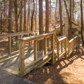 A set of stairs leading to one of the cozy cabin rentals. - Lake D'Arbonne State Park Campground