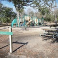 The campground has a playground.- Fontainebleau State Park Campground