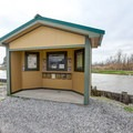 An information kiosk sits in the parking area with information about the greater wetlands conservation area.- White Lake Wetlands Conservation Area Birding + Nature Trail