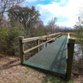 A network of several short trails are in the area. A bridge takes visitors to the interior trails.- White Lake Wetlands Conservation Area Birding + Nature Trail