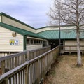 The Southwest Louisiana National Wildlife Refuge Complex Visitor Center stands in Cameron Prairie National Wildlife Refuge providing information, permits, boardwalk trails and interactive interpretive exhibits.- Cameron Prairie National Wildlife Refuge
