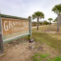 Grand Isle State Park is located at the end of a barrier island near the end of the Mississippi River along the gulf coast.- Grand Isle State Park