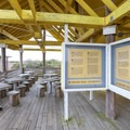 Informational kiosks line the tables and concessions area of the observation tower.- Grand Isle State Park