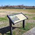 Informational signs placed around the historical battlefield.- Jean Lafitte National Historical Park + Preserve