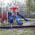 A playground stands outside in the park.- Lake Fausse Pointe State Park