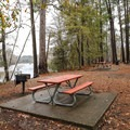 Picnic tables set along the edge of the park with views of the river below.- Sam Houston Jones State Park