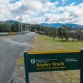 The control gates where you start the trek.- New Zealand Great Walks: Kepler Track