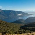 Low clouds dotting Lake Te Anau.- New Zealand Great Walks: Kepler Track