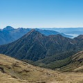 Epic peaks rising out of the water.- New Zealand Great Walks: Kepler Track