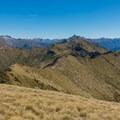 Tussock covered ridges.- New Zealand Great Walks: Kepler Track