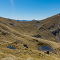 Alpine tarns dotting the valley on the descent.- New Zealand Great Walks: Kepler Track
