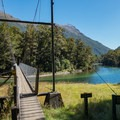 Swing bridge over the Clint River.- New Zealand Great Walks: Milford Track