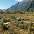 Information signs at the platform.- New Zealand Great Walks: Milford Track