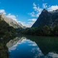 There are many spots for reflections over the Clint River.- New Zealand Great Walks: Milford Track