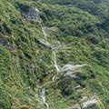 Dozens of falls dot the gorge.- New Zealand Great Walks: Milford Track