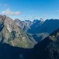 A sea of prominent cliffs fill the distance.- New Zealand Great Walks: Milford Track
