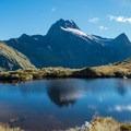 Many reflective tarns at Mackinnon Pass.- New Zealand Great Walks: Milford Track