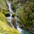 More deep blue water from cascades along the Milford Track.- New Zealand Great Walks: Milford Track