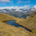 Tarn at Harris Saddle.- New Zealand Great Walks: Routeburn Track