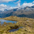 There are plenty of reflective tarns along the trail.- New Zealand Great Walks: Routeburn Track