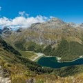 Panoramic views of the mountains surrounding the lake.- New Zealand Great Walks: Routeburn Track