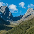 The towering peaks watching over the lake.- New Zealand Great Walks: Routeburn Track