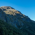 Earland Falls dropping into the valley.- New Zealand Great Walks: Routeburn Track