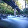 Small cascades run directly beneath the Route 702 bridge.- El Salto