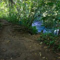 The trail parallels the river as it passes two side-by-side waterfalls.- El Salto
