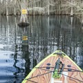 Bright yellow signs clearly guide paddlers up and down the trail. - Lake Chicot Water Trail