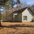 One of the two lodges offered for rent at Chicot State Park.- Chicot State Park Campground + Cabins