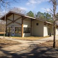 The group camping activity building offers comforts for larger groups. - Chicot State Park Campground + Cabins